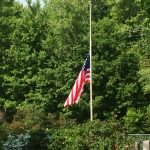 The US flag at half staff on Memorial Day at Olive Township Cemetery.