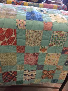 Feed sack quilt.