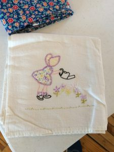 Embroidery on feed sack material.