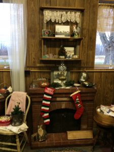 The stockings hung by the fireplace.