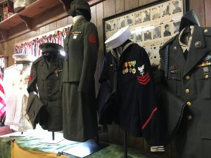 Male and female uniforms on display at Olive Township Museum.