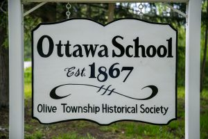 The sign stands in front of the Ottawa Schoolhouse on Stanton Street.