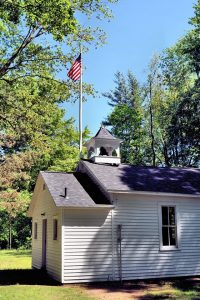 Flag flies at Pigeon Creek Schoolhouse.